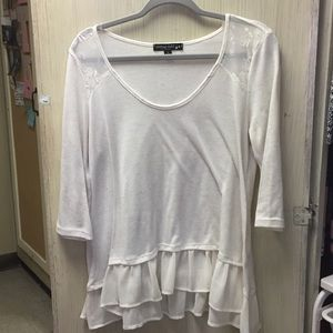 Cream top with lace trim and sheer detail